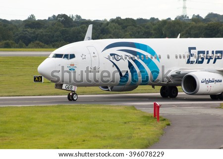 Manchester, United Kingdom - August 27, 2015: EgyptAir Boeing 737 narrow-body passenger plane (SU-GEB) taxiing on Manchester International Airport taxiway. - stock photo