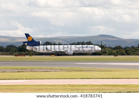Manchester, United Kingdom - August 27, 2015: Lufthansa Cargo MD-11 three-engine wide-body cargo plane taking off from Manchester International Airport runway.
