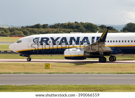 Manchester, United Kingdom - August 27, 2015: Ryanair Boeing 737-8AS (EI-ENP) taxiing on Manchester International Airport after landing. - stock photo