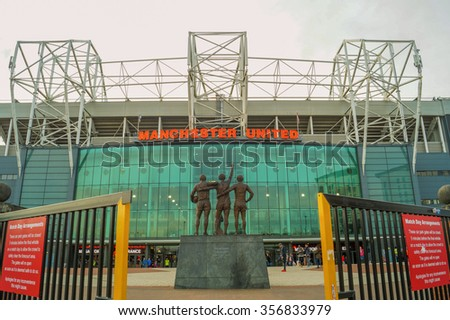 MANCHESTER, UNITED KINGDOM -29 DECEMBER 2015: The entrance of the Old Trafford stadium. Old Trafford is the home stadium of Manchester United Football Club since 1910. - stock photo