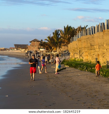 MANCORA, PERU - AUGUST 17, 2013: Unidentified people on the sandy beach on August 17, 2013 in Mancora, Peru. The small Northern Peruvian town of Mancora is a popular beach town. - stock photo