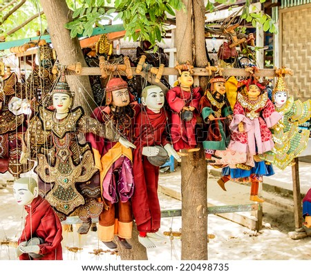 MANDALAY MAY23: Burmese puppets selling at the shop in Mandalay, Myanmar on May 23, 2014. Mandalay is the economic hub of Upper Myanmar and considered as the center of Burmese culture. - stock photo