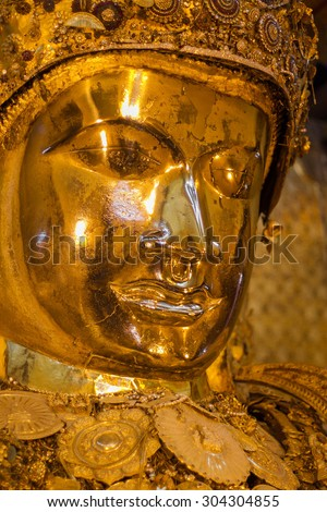 MANDALAY -MAY 25: The Myanmar people venerated Buddha statue with the golden paper at Mahamuni Buddha temple, May 25, 2015 in Mandalay, Myanmar. - stock photo