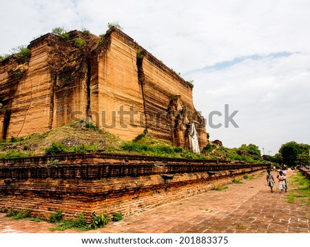 MANDALAY MAY23: tourists at  the ancient pagoda Mingun in Mandalay on May 23, 2014.  The Mingun temple is a monumental uncompleted pagoda began by King Bodawpaya in 1790. - stock photo
