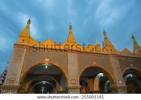 MANDALAY, MYANMAR - CIRCA January 2015: Myanmar arch gate of Sutaungpyai Pagoga, ancillary pavillion at the top of Mandalay Hill. From here is the best panoramic view 360 Mandalay in Myanmar (Burma). - stock photo