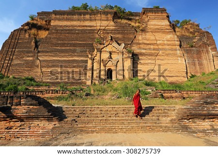 MANDALAY, MYANMAR- DEC 9 : Unidentified young Buddhism novices at Mingun Pagodaon on Dec 9, 2014 in Mandalay. It is ruins of the Pahtodawgyi pagoda and damaged by an earthquake - stock photo