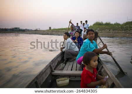 MANDALAY, MYANMAR - MAR 5: People living in a shanty town are crossing a river in Mandalay, Myanmar on the 5 March 2015. - stock photo