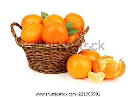 Mandarin in basket isolated on white - stock photo
