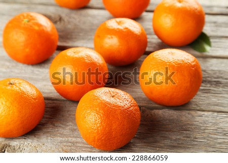 Mandarin on grey wooden background