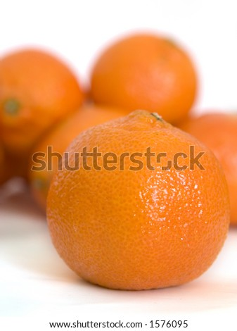 Mandarin orange close-up on oranges in background