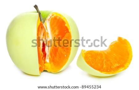 Mandarine in apple. Modification concept. - stock photo
