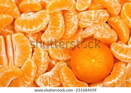 mandarine orange among mandarin slices  - stock photo
