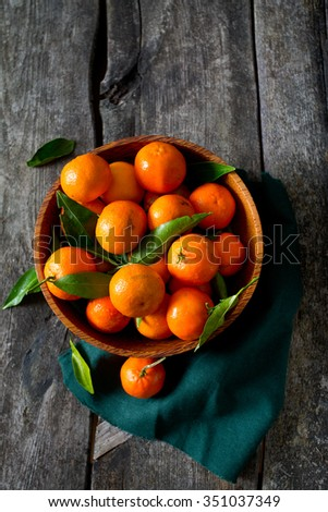 mandarines in a wooden bowl - stock photo