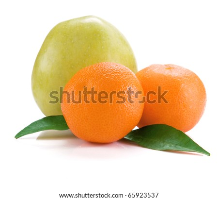 mandarins and apple isolated and green leaves on white background