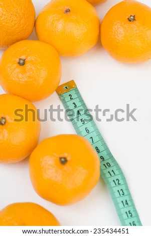Mandarins and the meter line closeup isolated - stock photo
