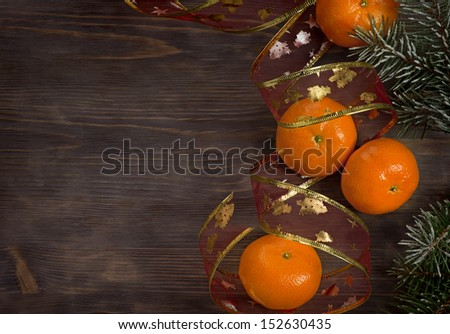 Mandarins on a board and fur tree - new year style - stock photo