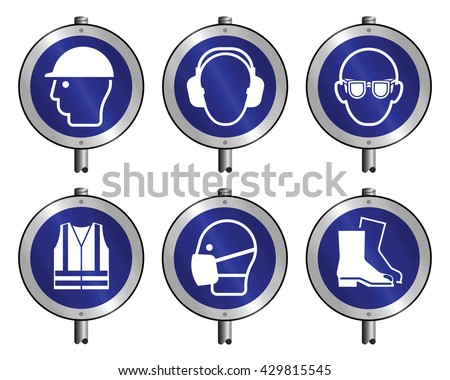 Mandatory construction manufacturing and engineering health and safety signs mounted on posts to current British Standards isolated on white background - stock photo