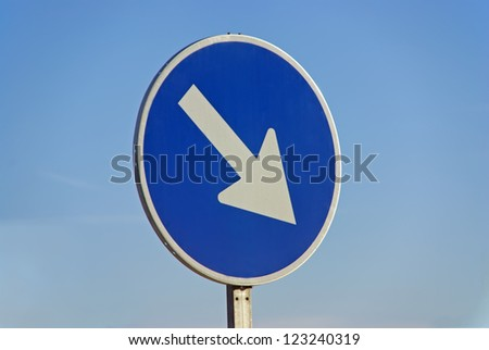 """Mandatory road sign indicating """"pass on right"""" - stock photo"""