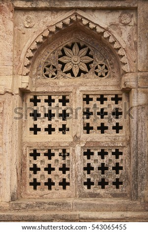 MANDU, MADHYA PRADESH, INDIA - NOVEMBER 18, 2008: Detail of stone window of Darya Khan's tomb in the hilltop fortress of Mandu. 16th Century AD