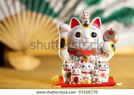 Maneki Neko cat. Common Japanese sculpture bring good luck to the owner. - stock photo
