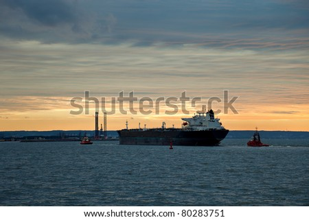 Maneuvering a large oil tanker at sea. - stock photo