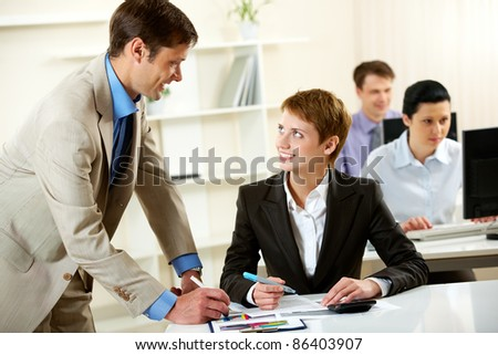 Manger consulting his young employee - stock photo