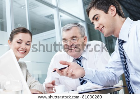 Manger explaining his strategy to his colleagues - stock photo