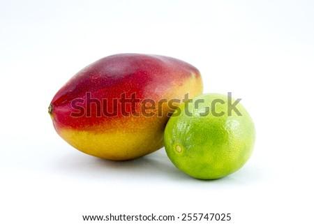 Mango and lime on white background - stock photo