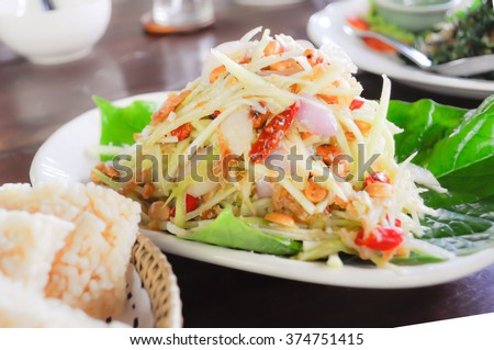 mango and papaya salad dish on the table
