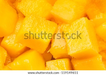 mango chunks full frame closeup - stock photo