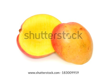 Mango in front of a white background - stock photo