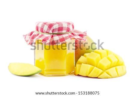 Mango jam with fresh mangoes on white - stock photo