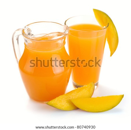 mango juice in a jug and a glass of fruit - stock photo