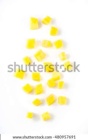 Mango slice cut to cubes isolated on white background. Top view.