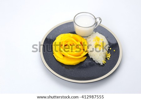 mango sticky rice with coconut milk place on plate