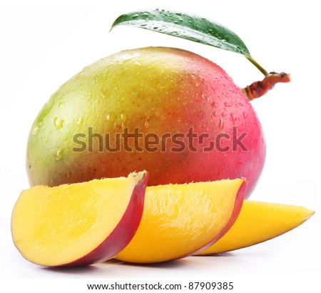 Mango with slices on a white background. - stock photo