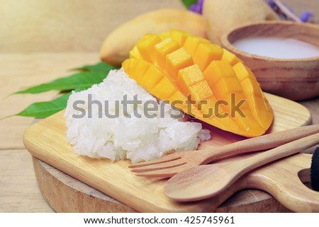 mango with sticky rice on wooden tray. thai dessert made from glutinous rice eat with mangoes and coconut milk.