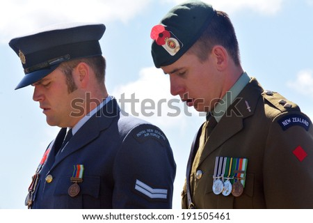 MANGONUI, NEW ZEALAND - APRIL 25 2014:New Zealand Army officers at attention during Anzac Day - War Memorial Service. - stock photo