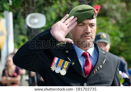 MANGONUI, NZ- APR 25 2012: Soldier of the New Zealand Army stands salut during Anzac Day - War Memorial Service.Over 18,000 New Zealand soldiers were killed in the First World War. - stock photo