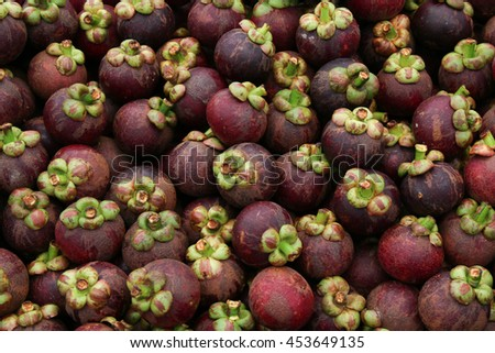 mangosteen is a popular and famous fruit in The market Thailand, mangosteen texture background.