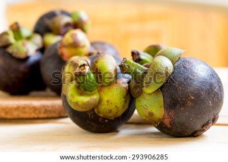 Mangosteen, Thailand's queen of fruits, dark purple peel and green part on the top, sweet and tasty  - stock photo
