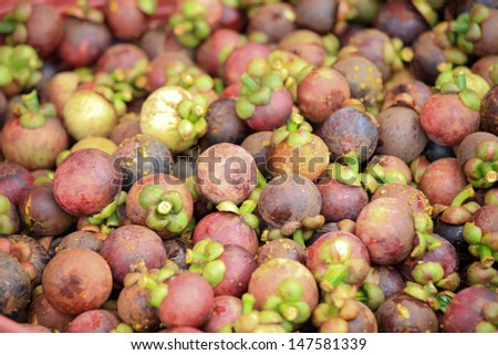 Mangosteen (tropical fruit) on sales in the market of Thailand