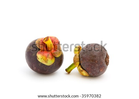 Mangosteens over white background