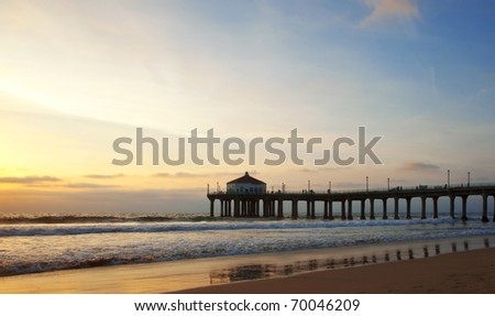 Manhanttan Beach Pier in Los Angeles, California just before sunset. - stock photo