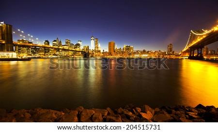 Manhattan and Brooklyn bridges at sunset - stock photo