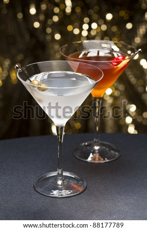 Manhattan and Martini cocktail nice garnished with gold glitter back ground - stock photo