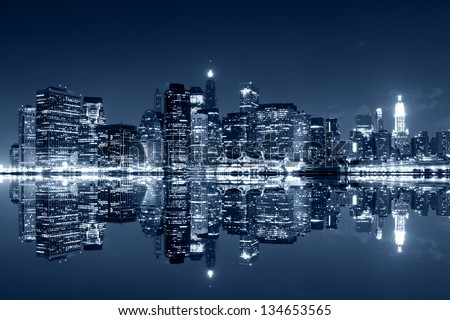 Manhattan at night, New York City. View from Brooklyn - stock photo