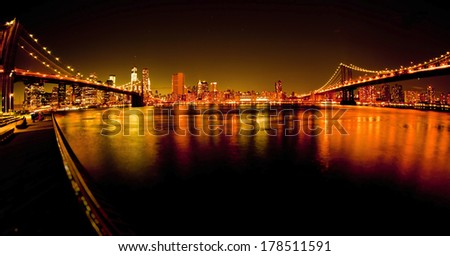 Manhattan Bridge and Brooklyn Bridge with Manhattan skyline At Night taken with fisheye lens  - stock photo