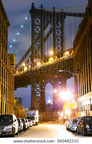 Manhattan Bridge and Empire State Building seen from Brooklyn at night - stock photo