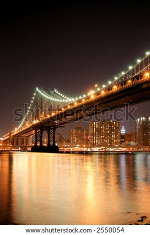 Manhattan Bridge and Manhattan skyline At Night